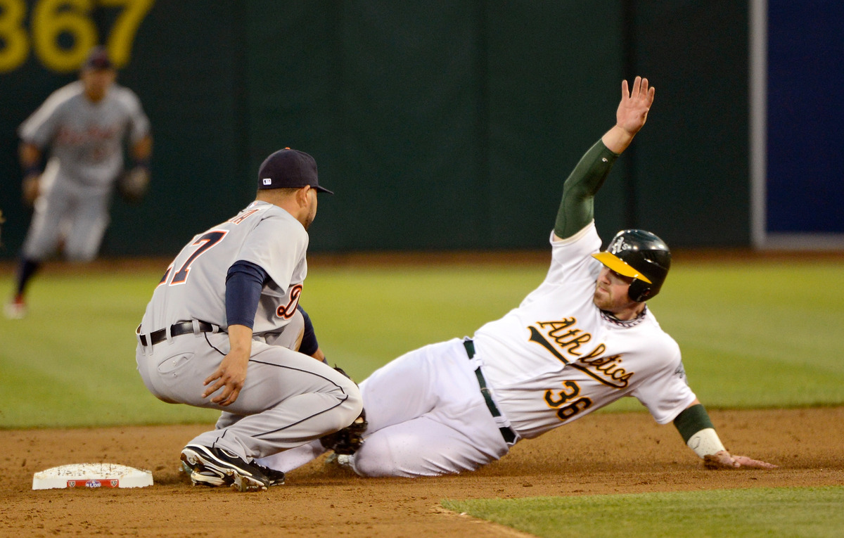Derek Norris #36 of the Oakland Athletics is tagged out by Jhonny Peralta #27 of the Detroit Tigers trying to steal second ba