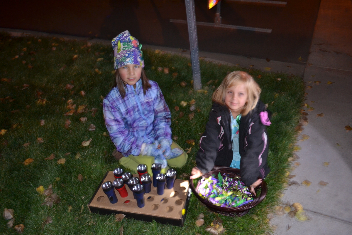 Two local girls made a basketful of purple and green ribbons with their moms and offered flashlights for Jessica Ridgeway's v