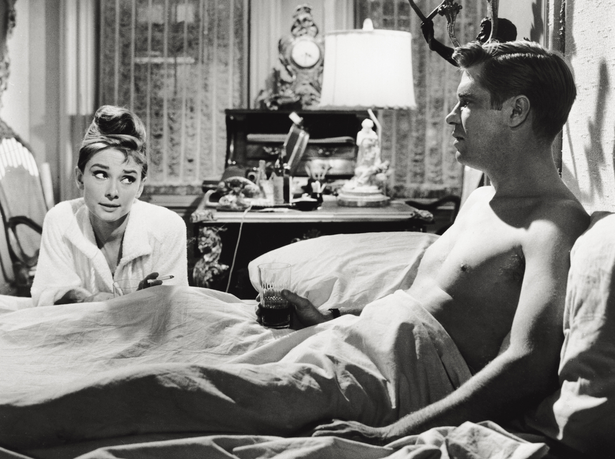 Audrey Hepburn acting with actor George Peppard in the film 'Breakfast at Tiffany's'. USA, 1960 (Photo by Mondadori Portfolio