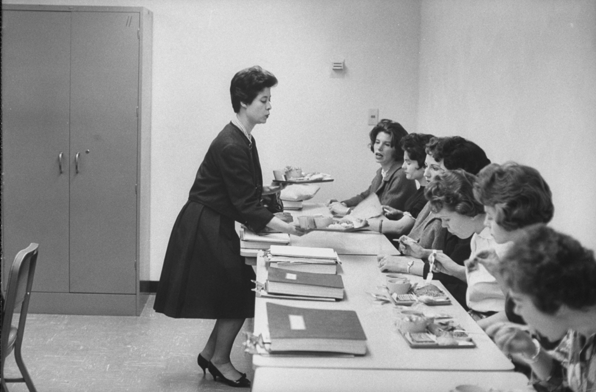Prospective stewardesses studying dining class at TWA school in 1961.