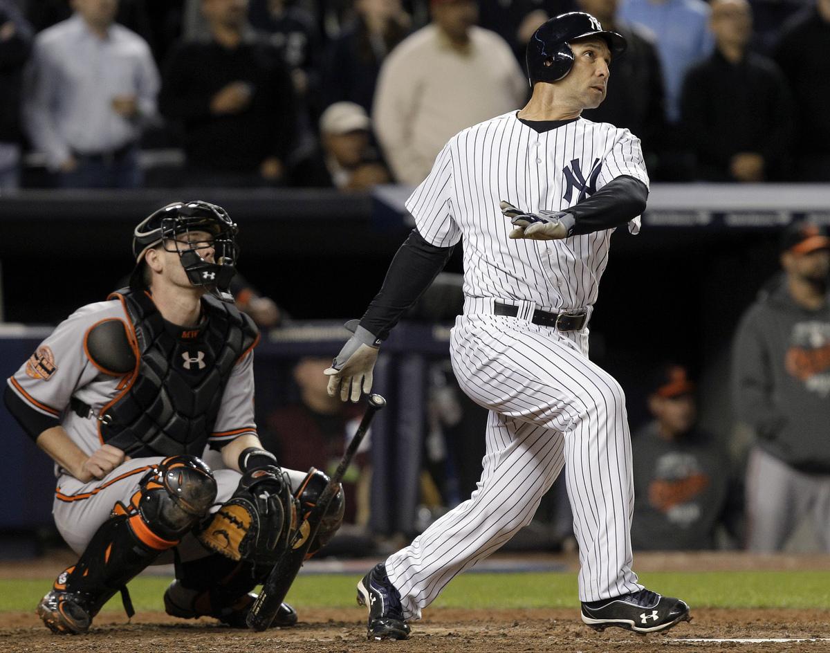 New York Yankees' Raul Ibanez follows through on a home run as Baltimore Orioles catcher Matt Wieters watches during the nint