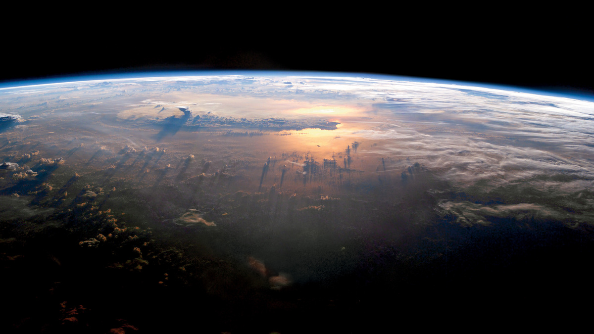 Sunset on the Pacific as seen from the International Space Station at an altitude of 235 miles.  ISS 007 crew, July 21, 2003