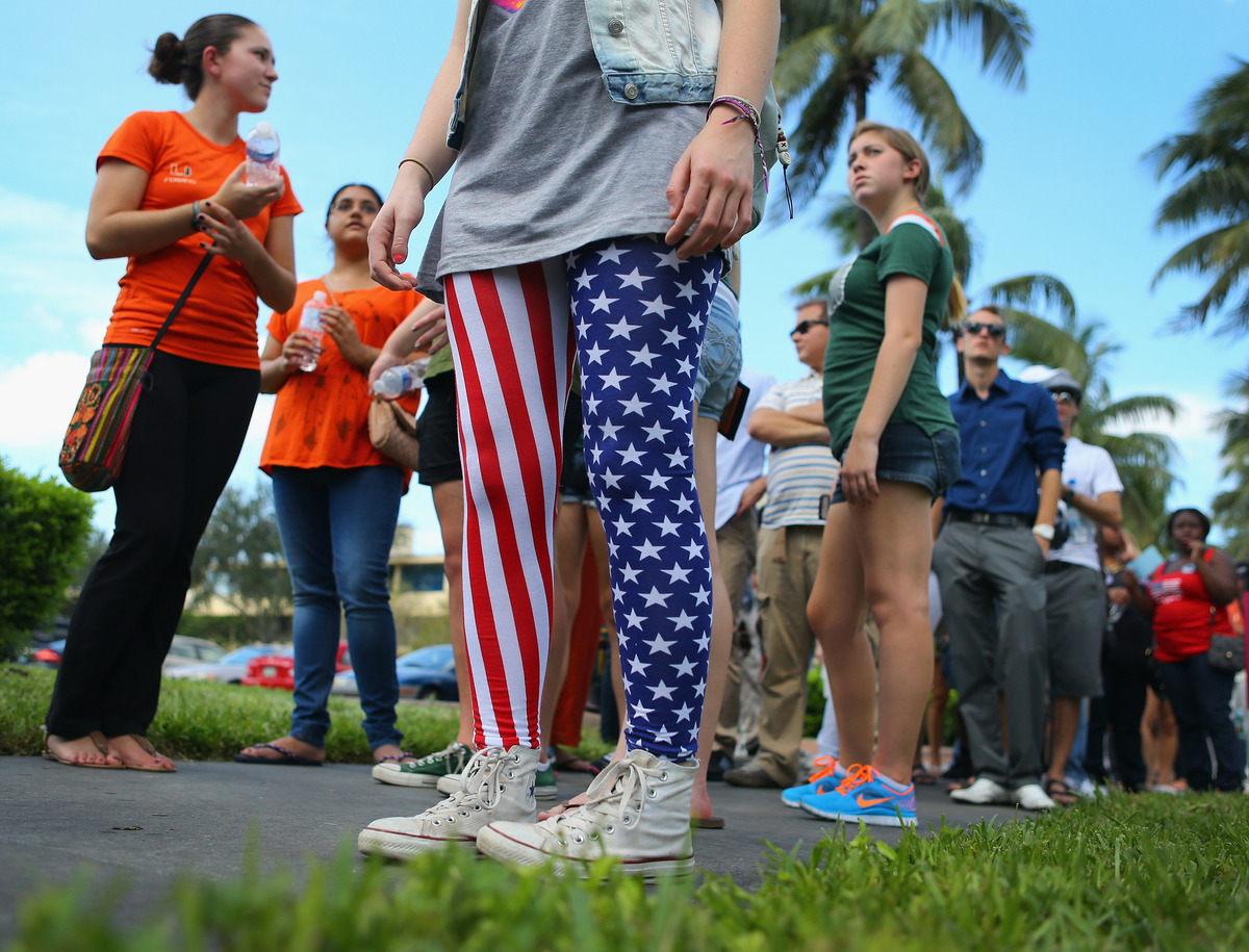 MIAMI, FL - OCTOBER 11:  Leah Friend wears American flag leggings as she waits in line to get into the  BankUnited Center at