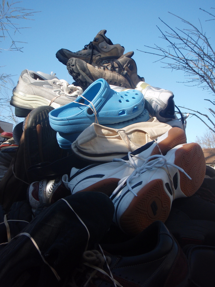 """Americans discarded more than <a href=""""http://www.soles4souls.org/about/green.html"""">300 million</a> pairs of shoes last year"""