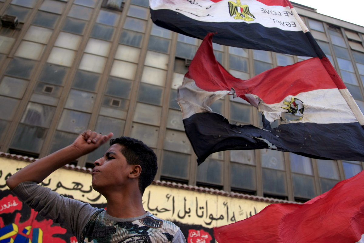 A protester chants slogans in Tahrir Square in Cairo, Egypt, Friday, Oct. 12, 2012. (AP Photo/Khalil Hamra)