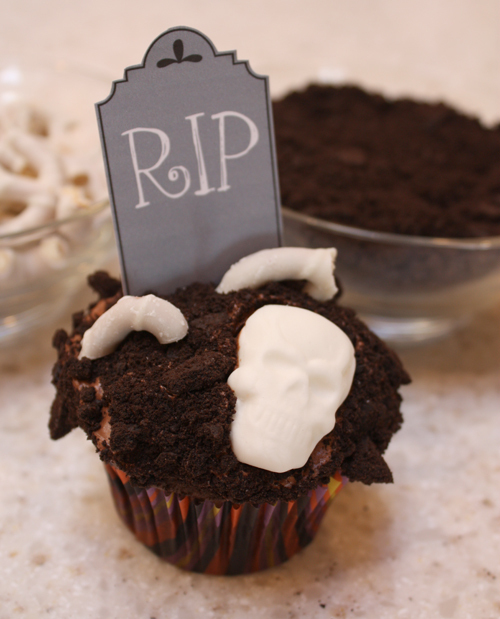This printable also comes with instructions on how to make these creepy cupcakes, complete with skeleton parts. This is one g