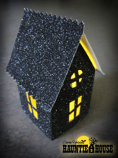 """Light up your window or front porch with this spooky, glowing haunted house.  (Photo by <a href=""""http://justsomethingimade.co"""