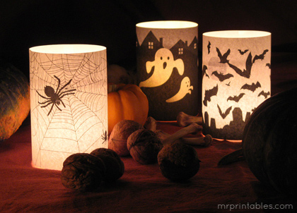 """Wrap these images onto plain glass candle holders to create creepy luminaries in no time.  (Photo by <a href=""""http://www.mrpr"""