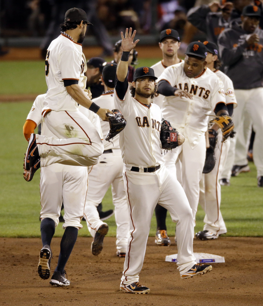 San Francisco Giants' Angel Pagan leaps in the air as he celebrates with teammates after Game 2 of baseball's National League