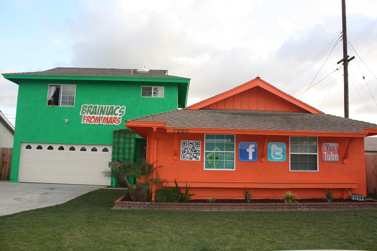 """<a href=""""http://brainiacsfrommars.com/"""">Brainiacs from Mars</a> paints houses in bright colors then attaches removable ads. I"""