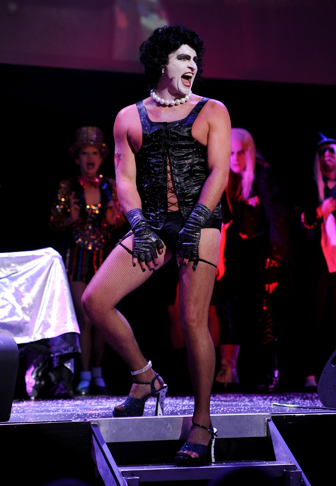 """Needs: high heels, tights, red lipstick, wig, corset.  <a href=""""http://www.rockyhorrorcostumelist.info/"""">Or you can go really"""
