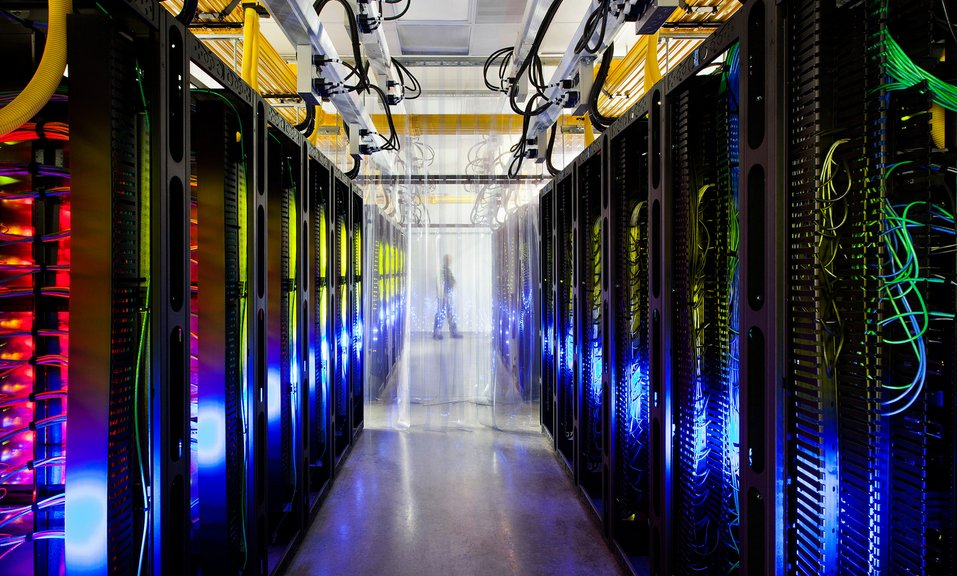 "From Google: ""Inside our campus network room, routers and switches allow our data centers to talk to each other. The fiber op"