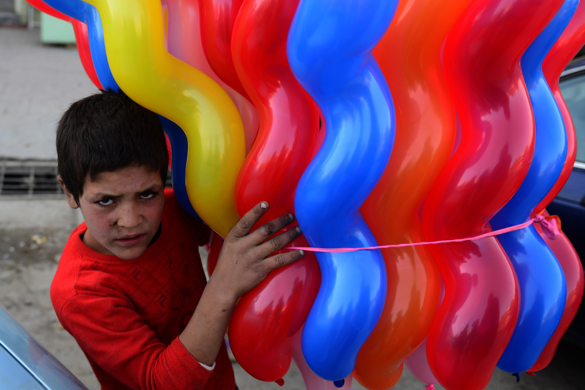 An Afghan child vendor sells balloons in Kabul on October 16, 2012. (MUNIR UZ ZAMAN/AFP/Getty Images)