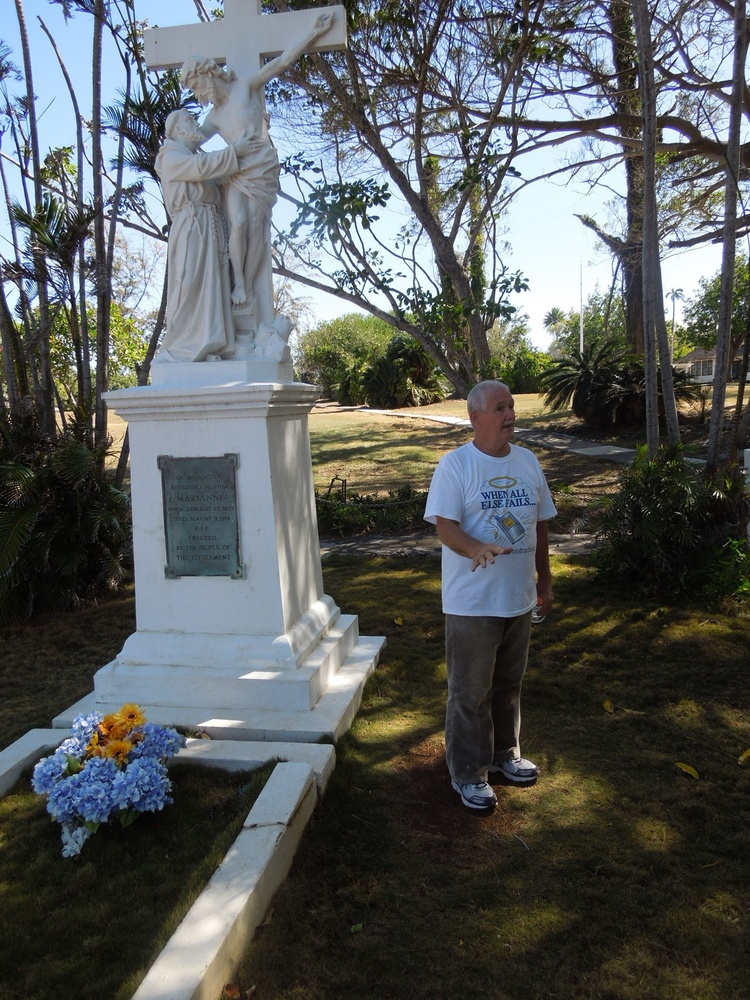 Tour guide Norman Soares stands at the Mother Marianne monument at Kalaupapa on the Hawaiian island of Molokai.