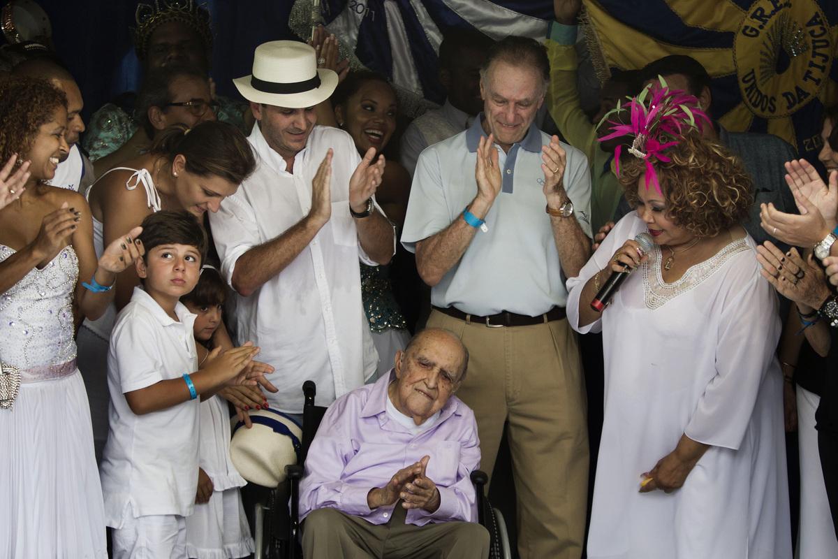 Brazilian architect Oscar Niemeyer, 104, bottom center, Rio de Janeiro's Mayor Eduardo Paes, center left, and Brazil Olympic