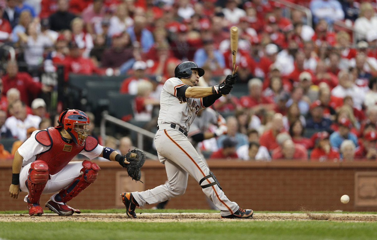 San Francisco Giants' Gregor Blanco (7) breaks his bat as he hits a foul ball during the sixth inning of Game 3 of baseball's