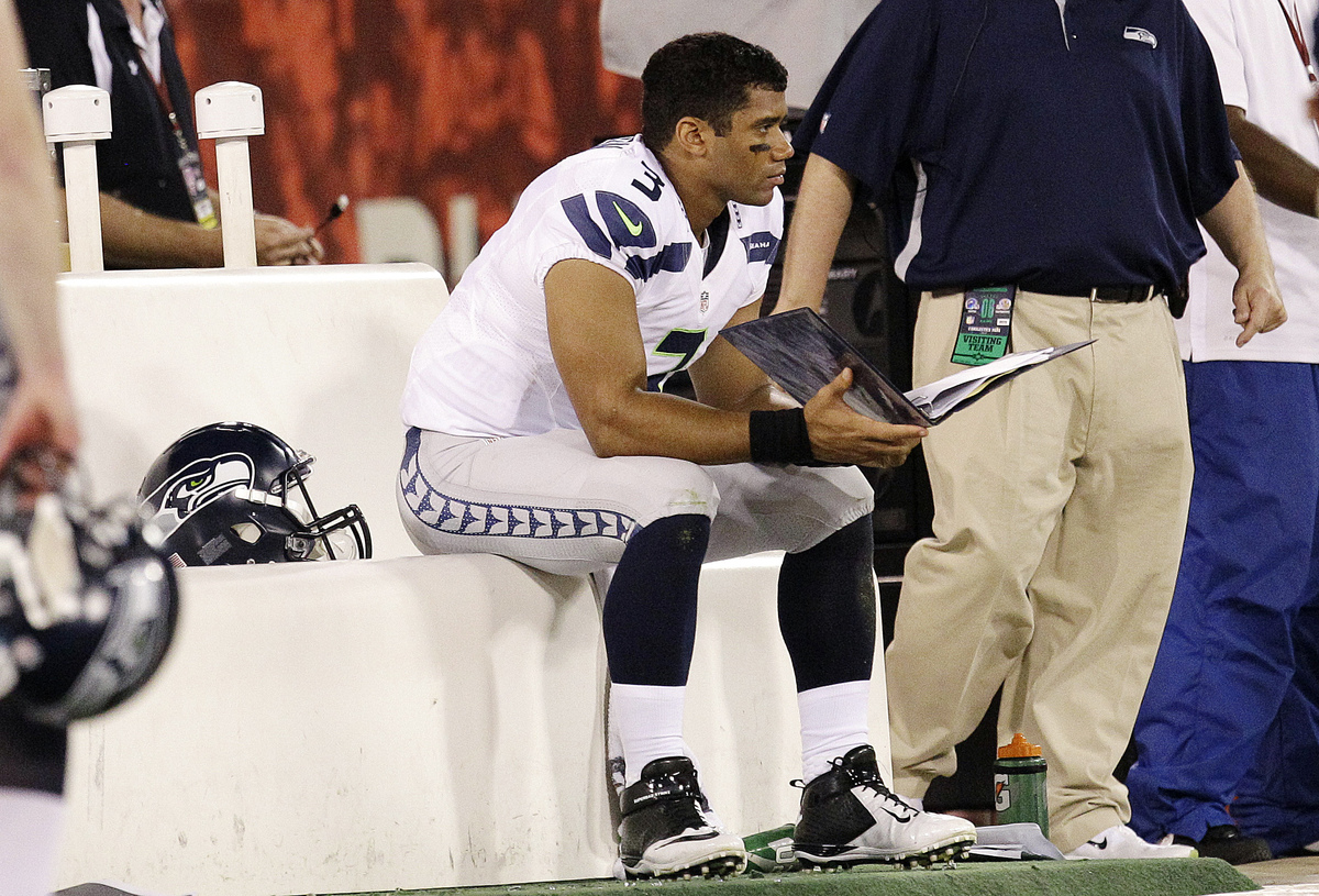Seattle Seahawks quarterback Russell Wilson (3) sits on the bench during the fourth quarter of an NFL football game against t