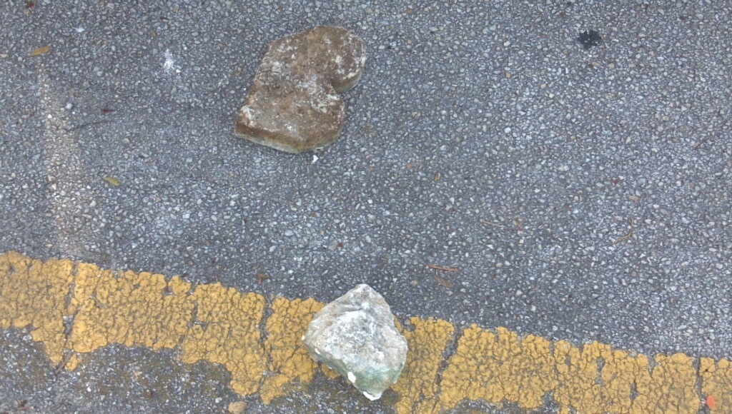 The concrete rocks that Jack Scott allegedly threw at the police vehicle and the officer.
