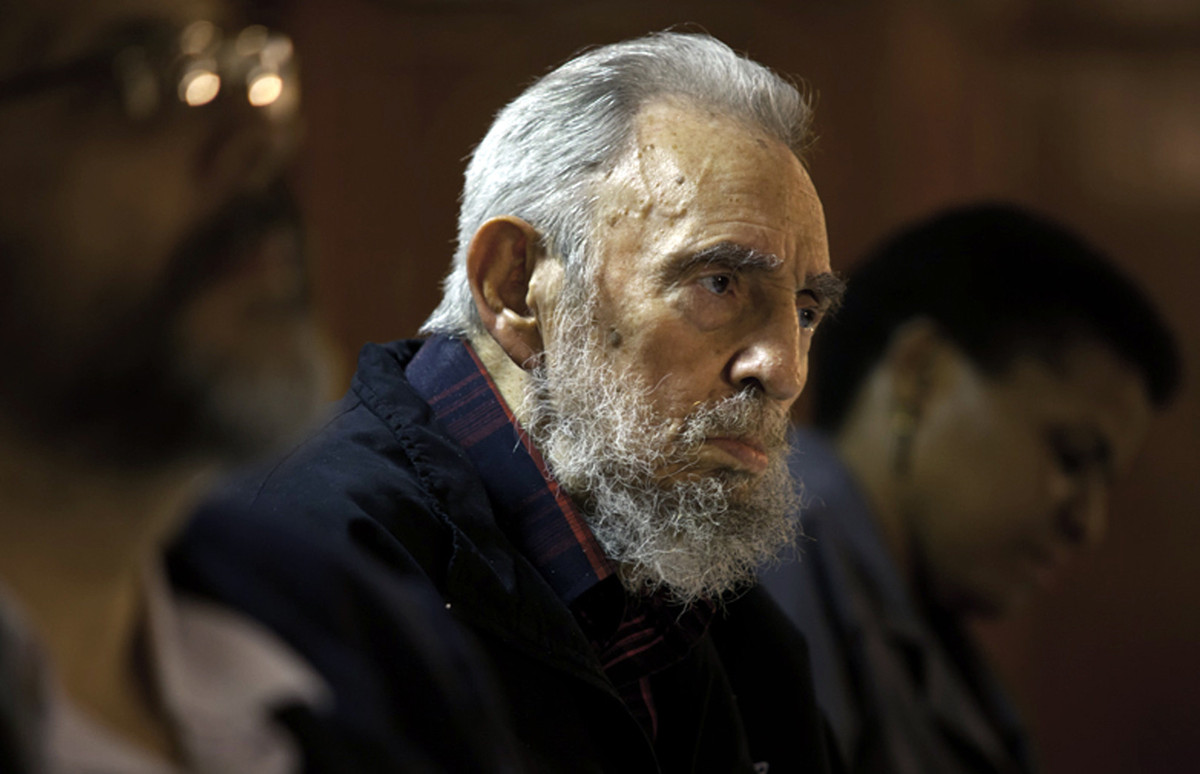 In this Feb. 10, 2012, file photo released by the state media website Cubadebate, Fidel Castro attends a meeting with intelle