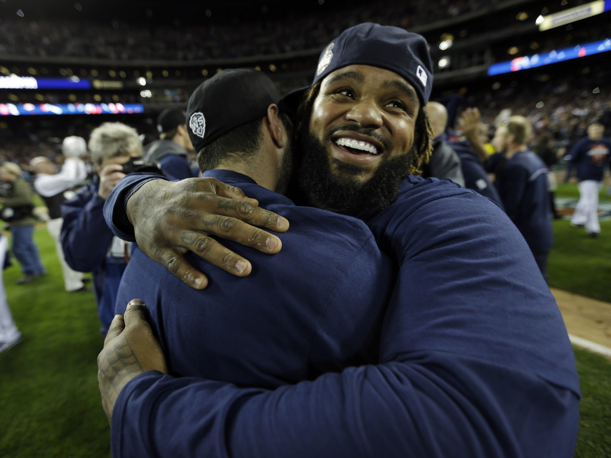 Detroit Tigers' Prince Fielder celebrates with a teammate after winning Game 4 of the American League championship series, 8-