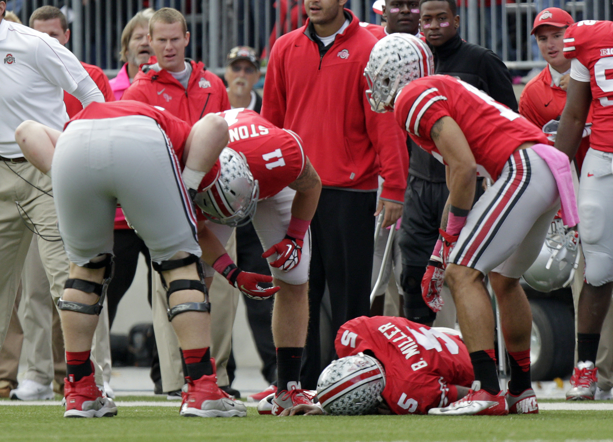 Ohio State quarterback Braxton Miller lies injured on the ground after being tackled by a Purdue player during the third quar