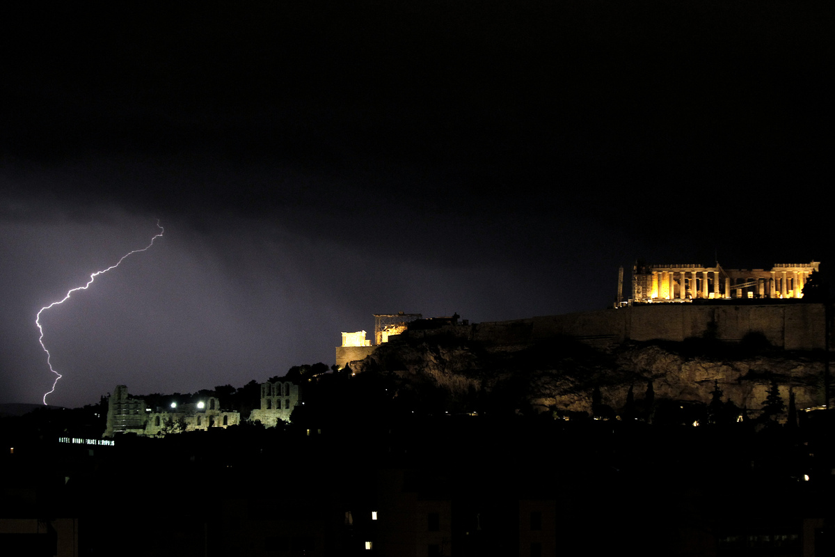 Lighting strikes by the Parthenon, on the Acropolis overlooking Athens during a thunderstorm that broke over the Greek capita