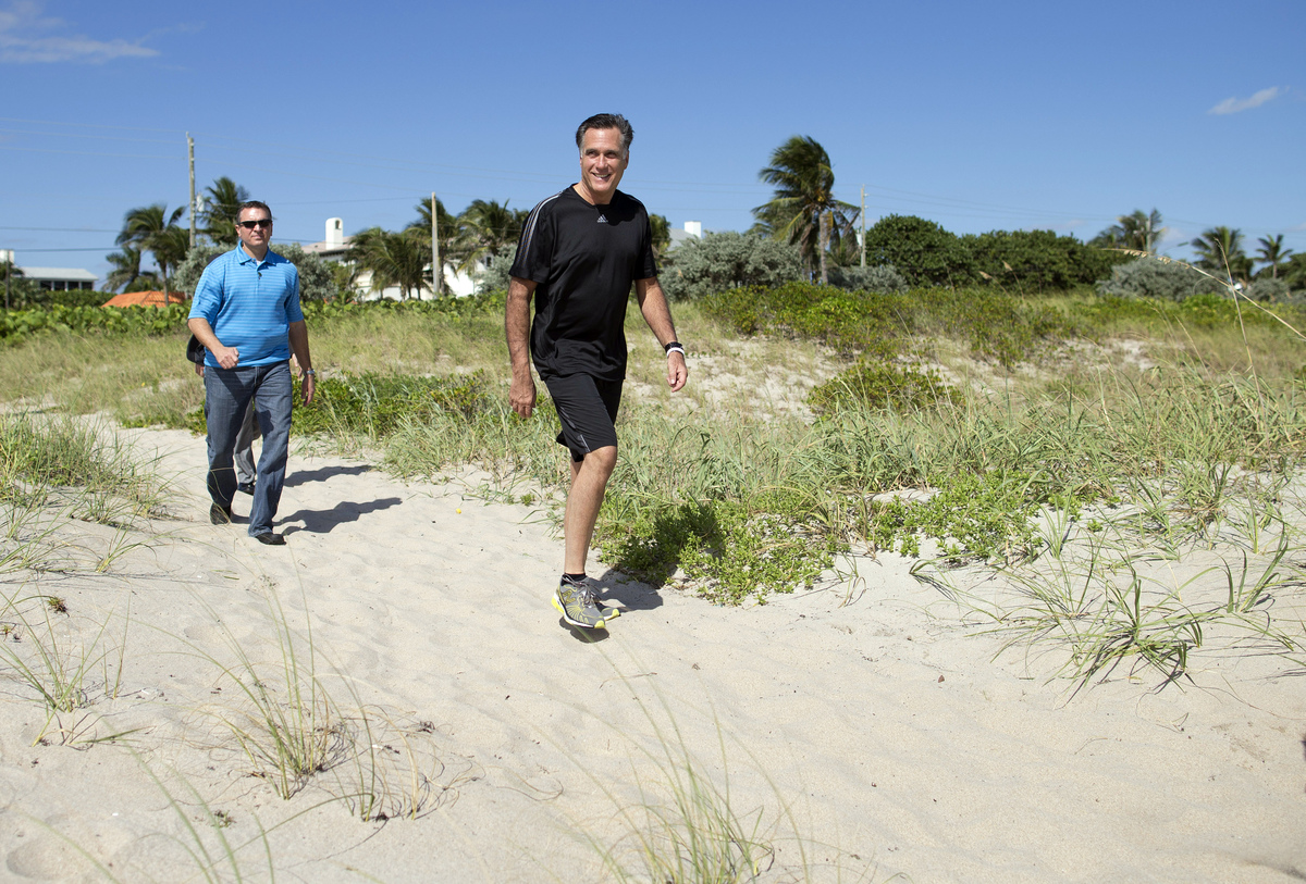 Republican presidential candidate, former Massachusetts Gov. Mitt Romney arrives on the beach to watch a flag football game b
