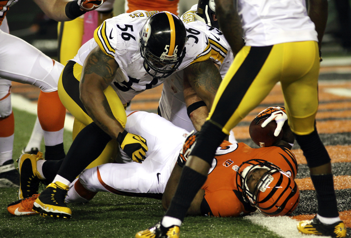 Cincinnati Bengals running back Cedric Peerman (30) falls into the end zone for a five-yard touchdown past Pittsburgh Steeler
