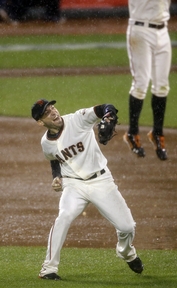 San Francisco Giants' Marco Scutaro reacts after the final out in Game 7 of baseball's National League championship series ag