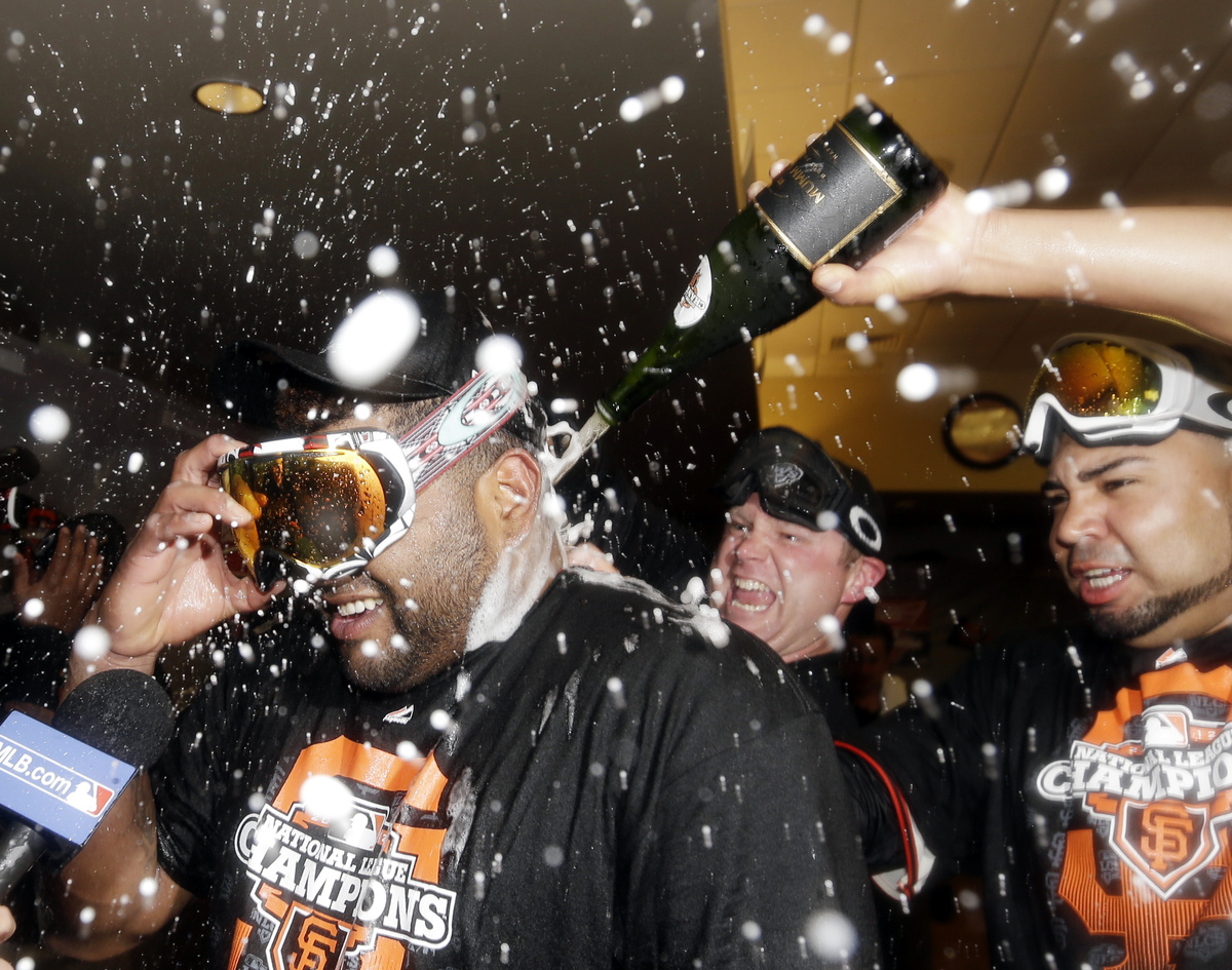 San Francisco Giants' Pablo Sandoval celebrates after Game 7 of baseball's National League championship series against the St