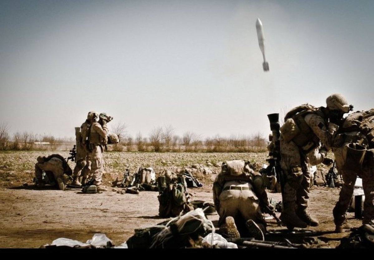 MARJAH, Afghanistan -The 81mm mortar-men attached to Bravo Company, 1st Battalion, 6th Marine Regiment open fire with their w