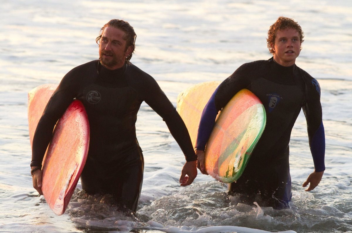 "Gerard Butler (L) as ""Frosty"" Hesson and newcomer Jonny Weston as surf legend Jay Moriarity in Chasing Mavericks, which was f"