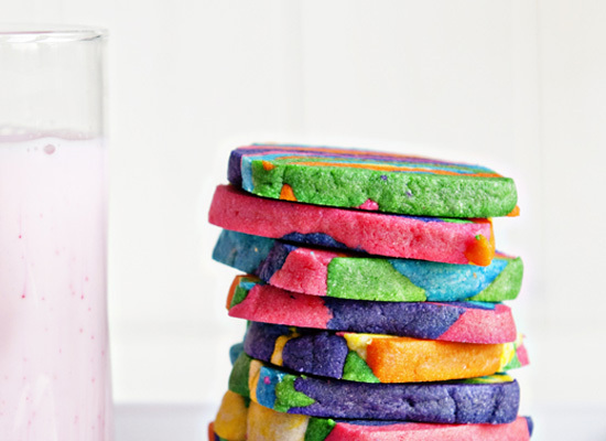 """<strong>Get the <a href=""""http://dineanddish.net/2012/10/simple-joy-recipe-rainbow-tie-dyed-sugar-cookies/"""">Rainbow Tie-Dyed S"""
