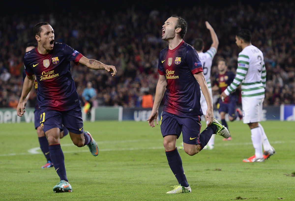 FC Barcelona Andres Iniesta, center, reacts after scoring during a Champions League soccer match group G against Celtic at th