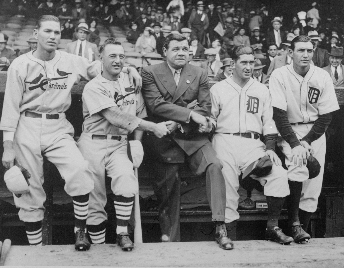 A group of baseball celebrities pose together before the start of the opening game of the World Series between St. Louis Card