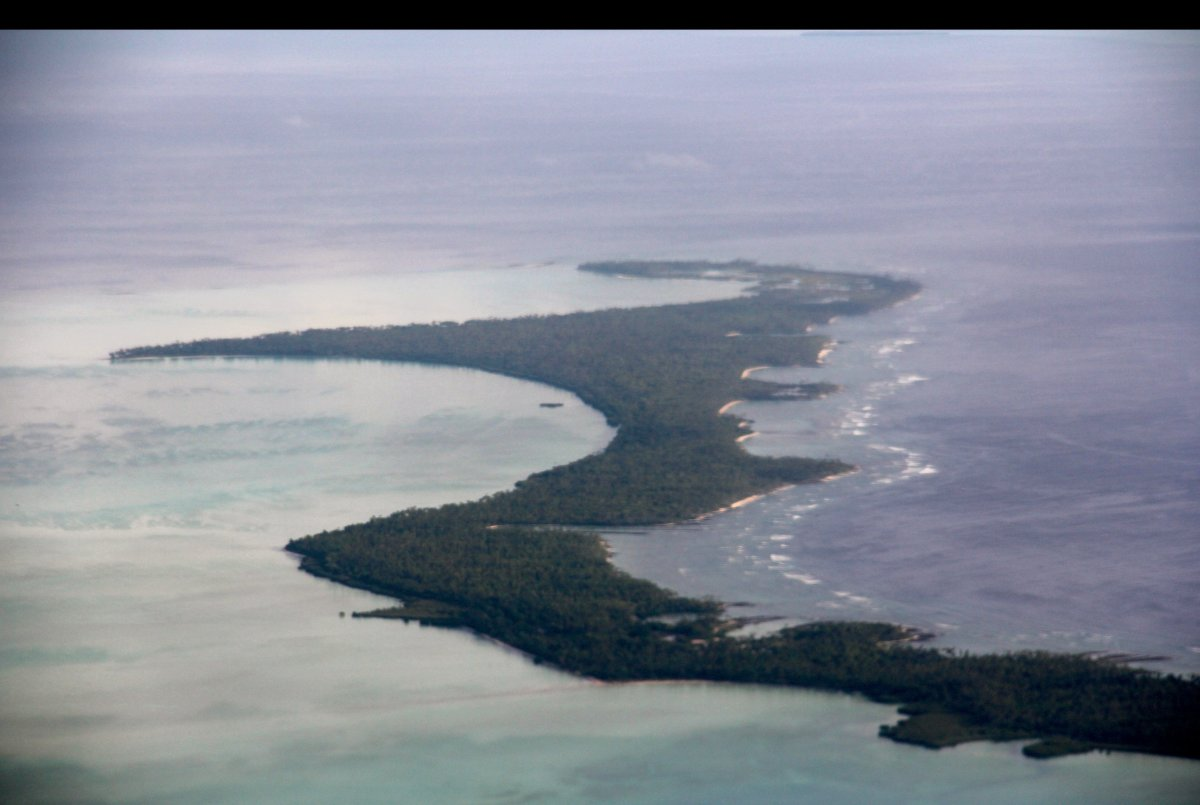 The islands of Kiribati, in the equatorial pacific, are spread out of 3.5 million square miles. Flying over them is truly a f