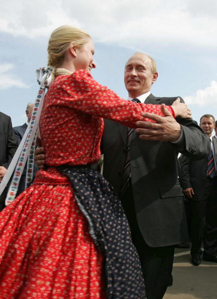 Russian President Vladimir Putin dances during an opening ceremony of an ethnic festival in Saransk, some 600 km from Moscow,