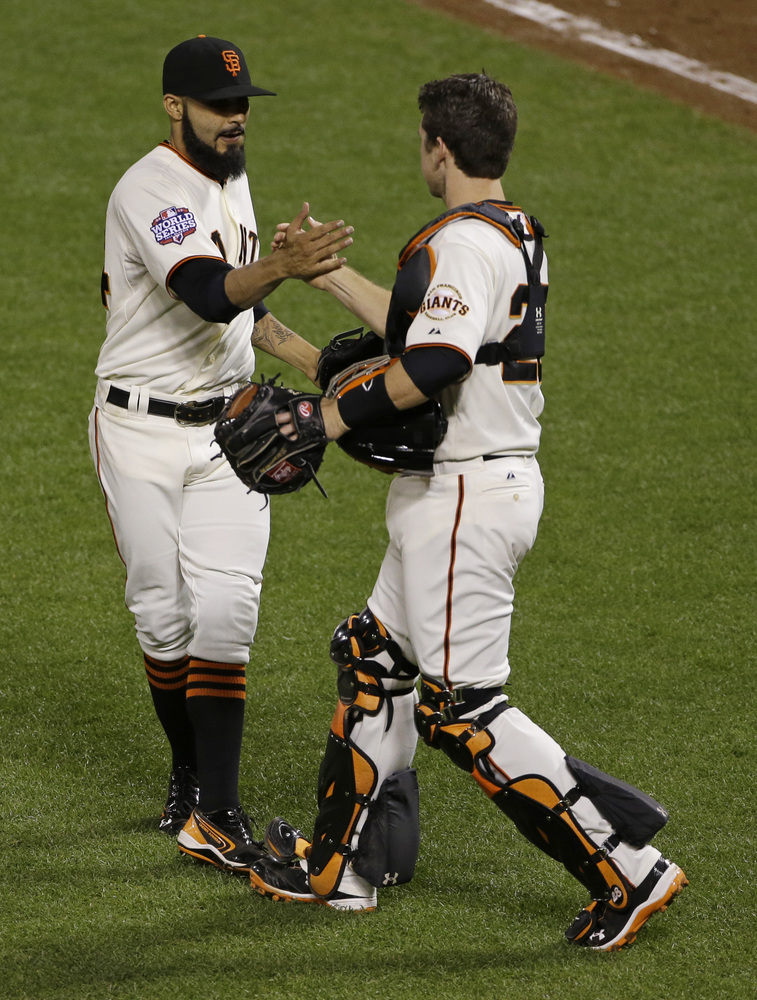 San Francisco Giants' Sergio Romo is congratulated by catcher Buster Posey after the Giants defeated the Detroit Tigers, 2-0,