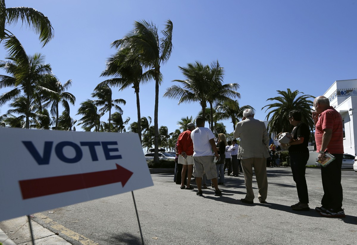 FILE - This Oct. 29, 2012 file photo shows people standing in line to vote in the presidential election, in Miami. There's al