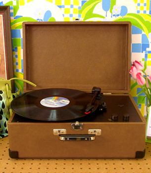 """<a href=""""http://www.fredflare.com/SALE/Crosley-Keepsake-USB-Turntable/"""">$129.95 from Fred Flare </a>"""