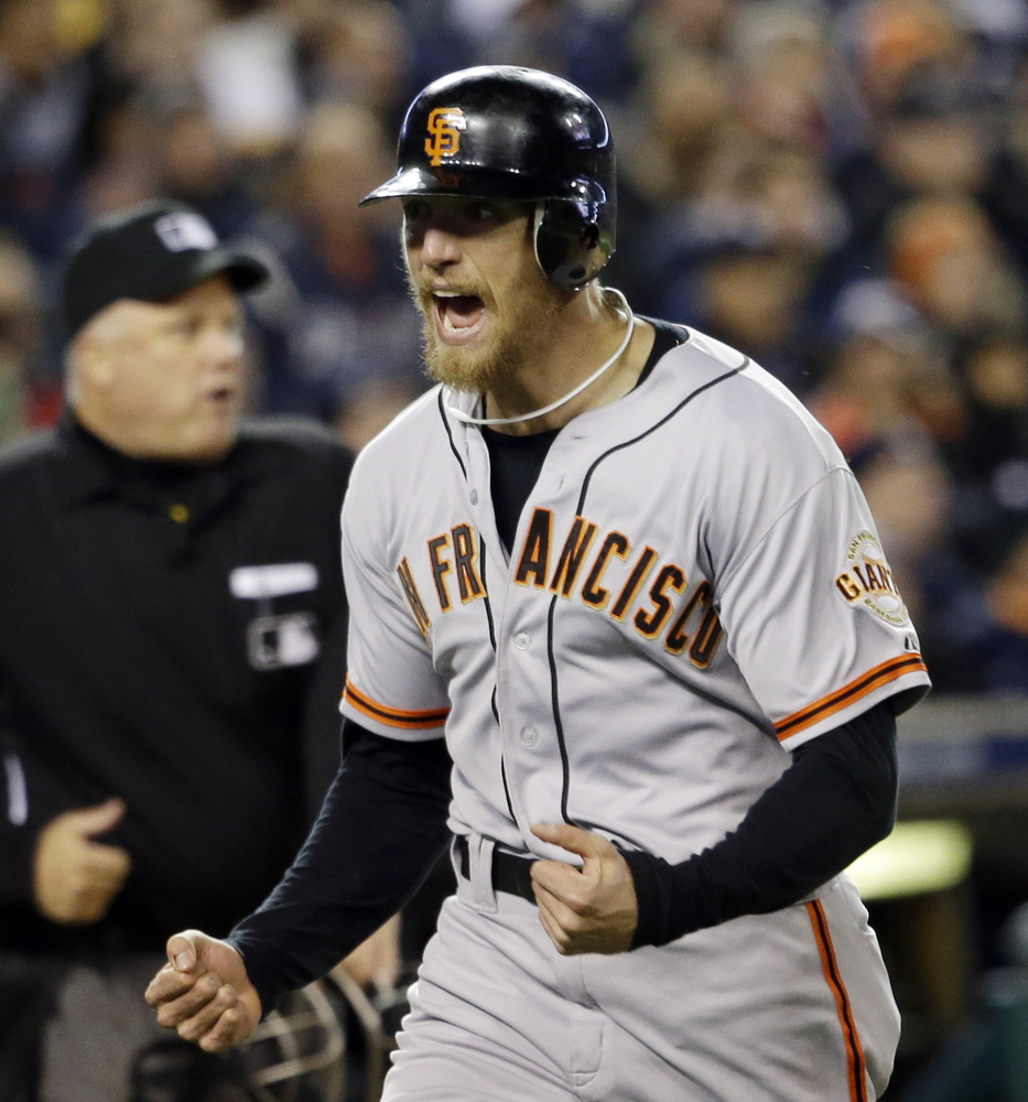 San Francisco Giants' Hunter Pence reacts as he runs home to score a run during the second inning of Game 4 of baseball's Wor