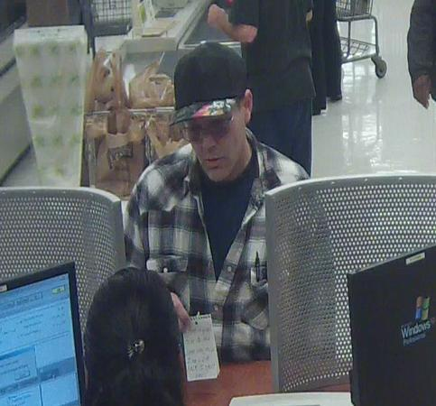 The Elmer Fudd Bandit's MO is approaching a teller and showing a note demanding cash.