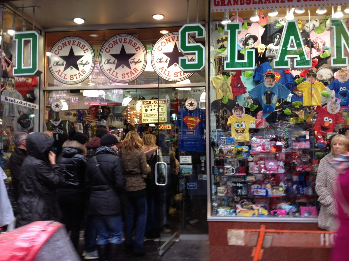 Shoppers stood outside the souvenir store Grand Slam in Times Square on Monday around noon.