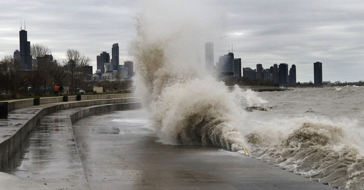 Strong waves crash against the Lake Michigan waterfront at the 31st Street Beach on the south side of Chicago on Tuesday, Oct
