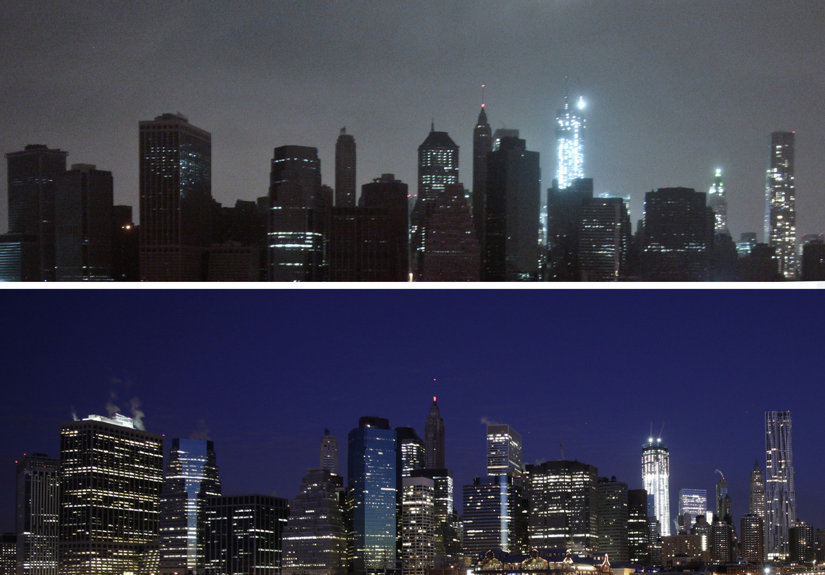 This combination of photos shows above, lower Manhattan dark after the hybrid storm Sandy on Monday, Oct. 29, 2012, and below