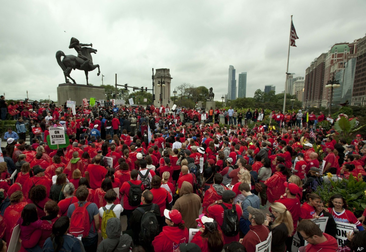 A large crowd of public school teachers rally at Chicago's Congress Plaza to protest against billionaire Hyatt Hotel mogul Pe