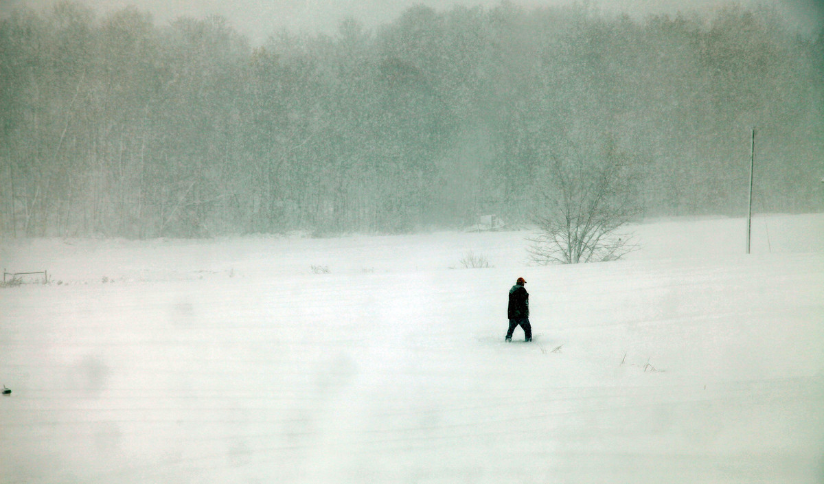 A person walks through snow Tuesday, Oct. 30, 2012, in Belington, W.Va. Superstorm Sandy buried parts of West Virginia under