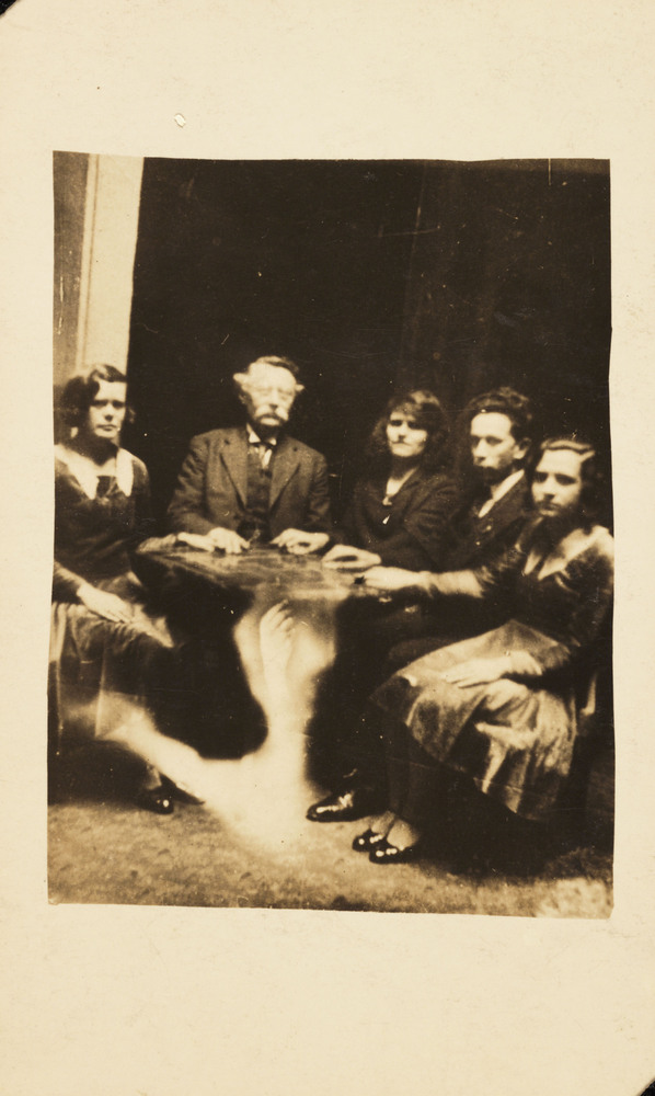 A photograph of a group gathered at a seance, taken by William Hope (1863-1933). The information accompanying the spirit albu