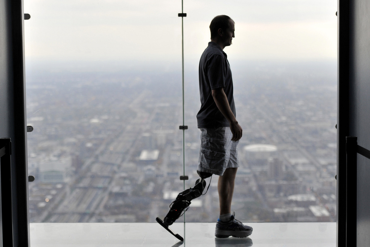 """In this Oct. 25, 2012 photo, Zac Vawter, fitted with an experimental """"bionic"""" leg, is silhouetted on the Ledge at the Willis"""