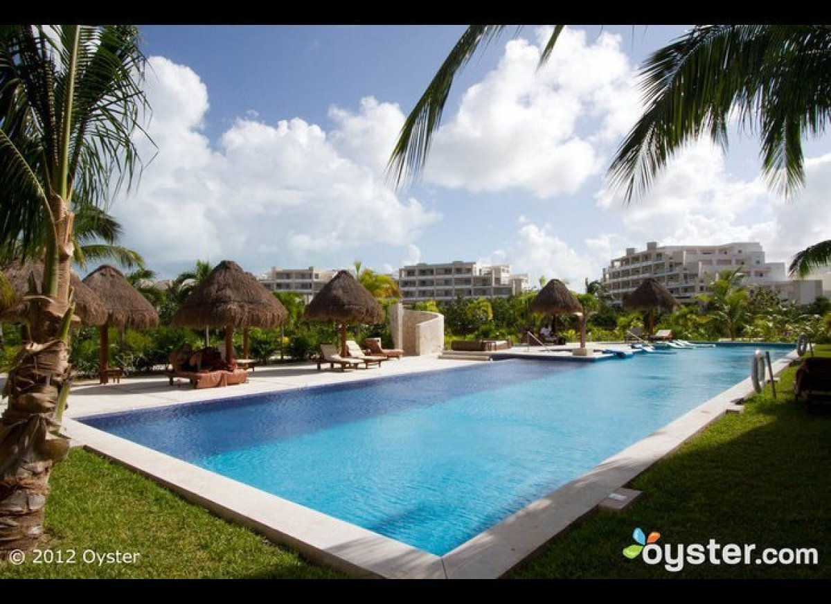 """This <a href=""""http://www.oyster.com/cancun/hotels/excellence-playa-mujeres/"""" target=""""_hplink"""">adults-only luxury resort</a> o"""